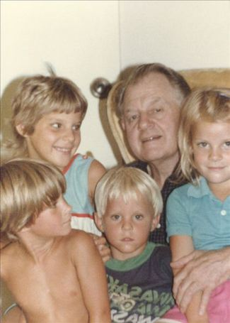 George A. Baker, 1985 w/ four fair headed grandchildren, Gus, Katie, David, and Julianne.
