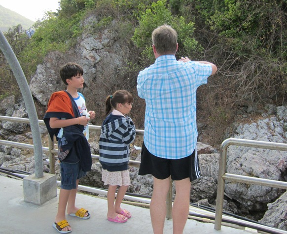 Bill, Leanna, and Dad explaining lava rock and island formation at Koh Larn, Thailand 2012